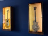 acoustic and electric guitars displayed
